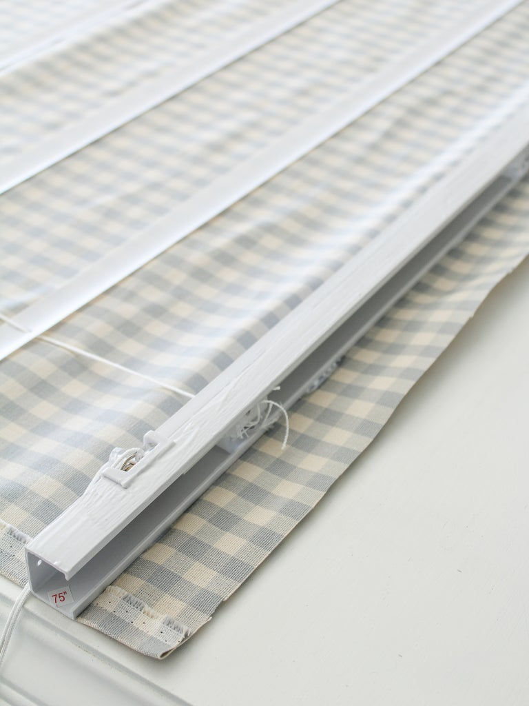 cut up blinds sitting on fabric