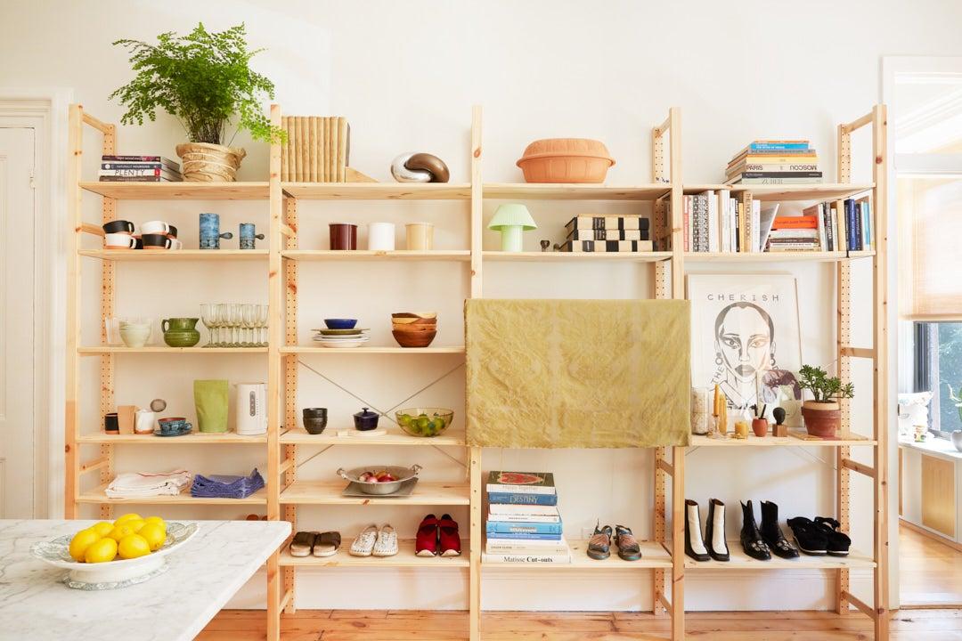 IKEA Ivar bookshelf with books and shoes