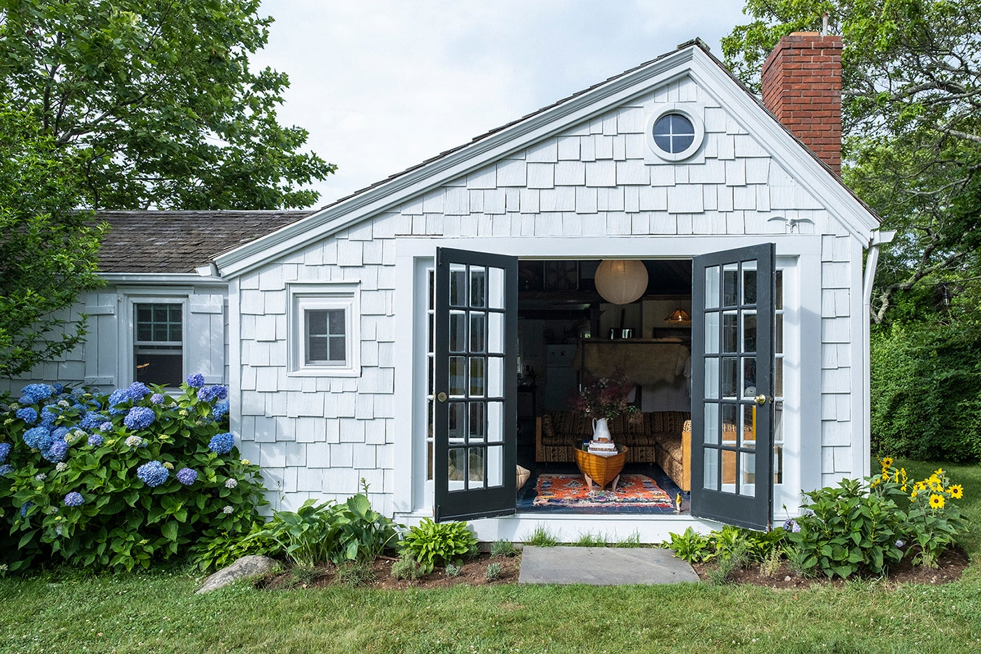 cottage with doors open