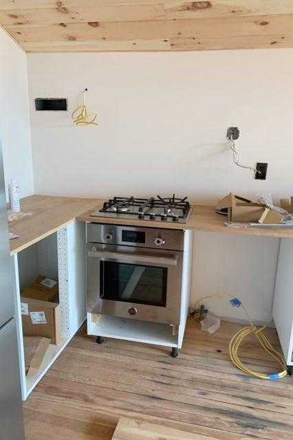 kitchen cabnets being installed