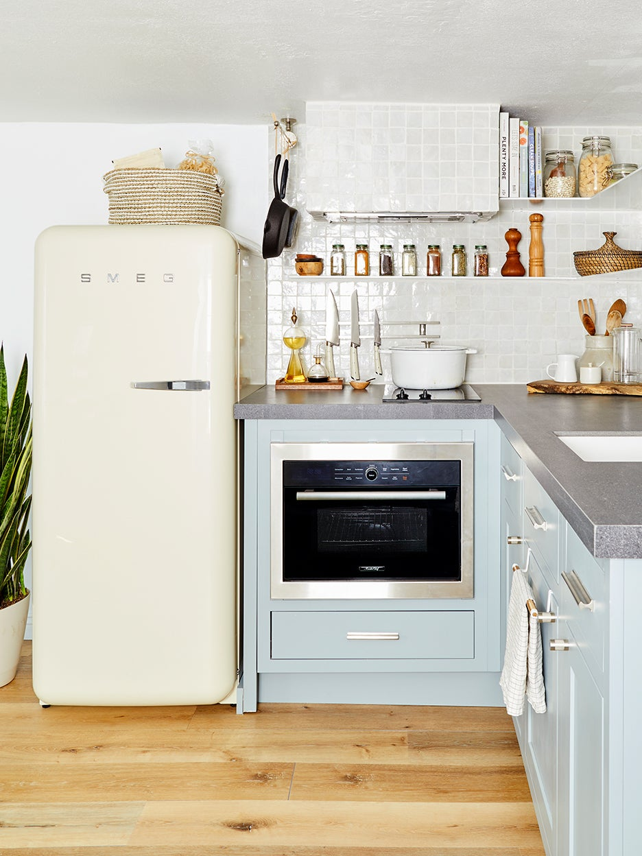 white fridge in a blue kitchen