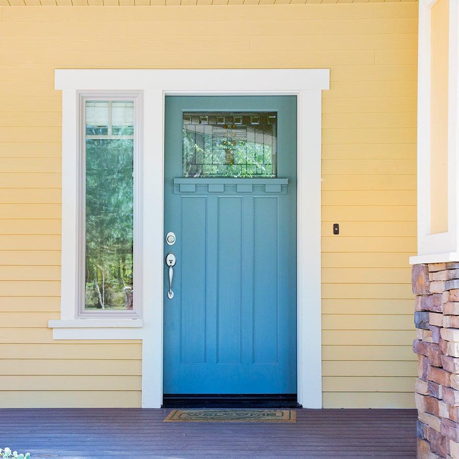 yellow home with blue door