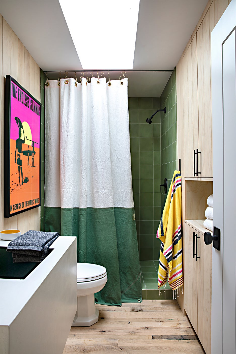wood bathromo with green tile shower