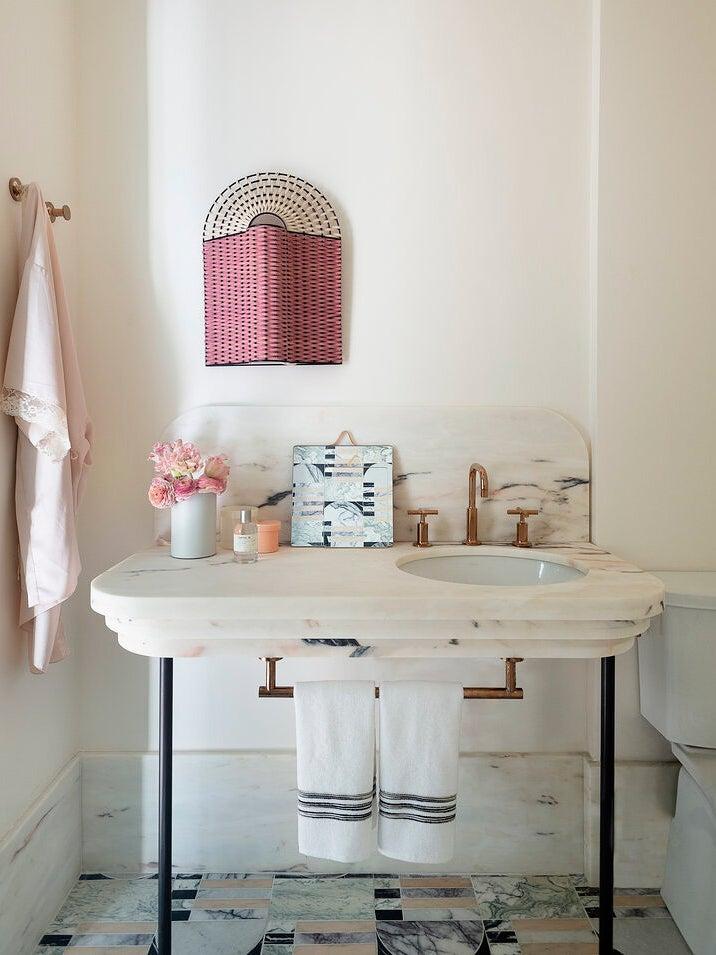 Art Deco vanity in blush bathroom