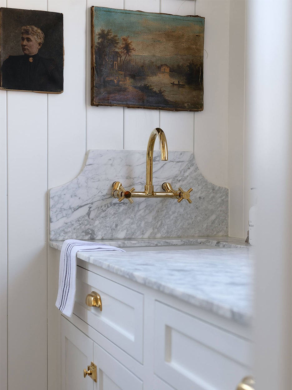 Statement marble backsplash with brass tap