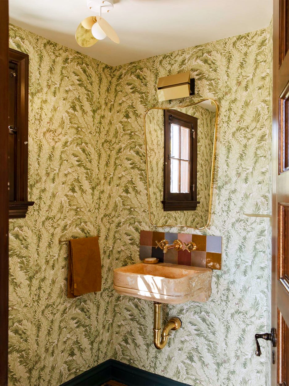 green wallpapered bathroom
