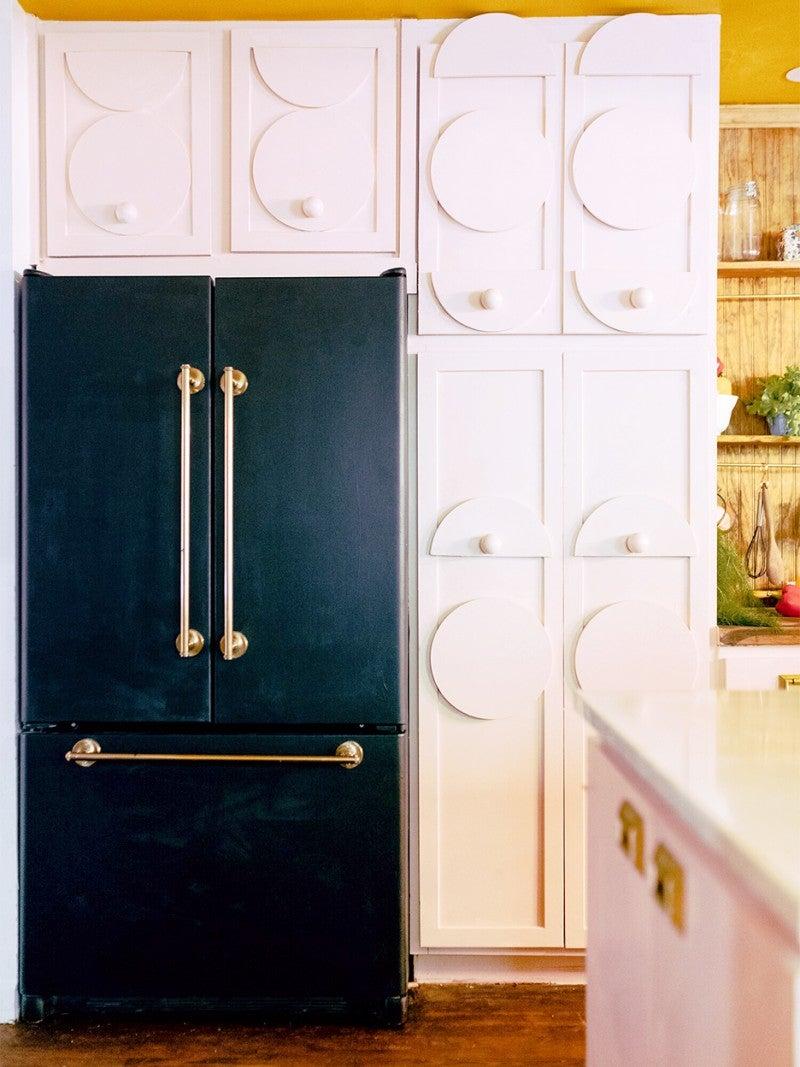 black fridge and white cabinets
