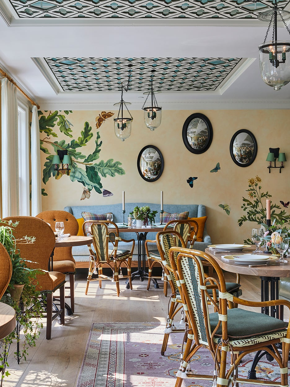 dining room with wall paper on ceiling