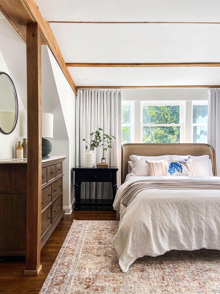 bedroom with wood beams