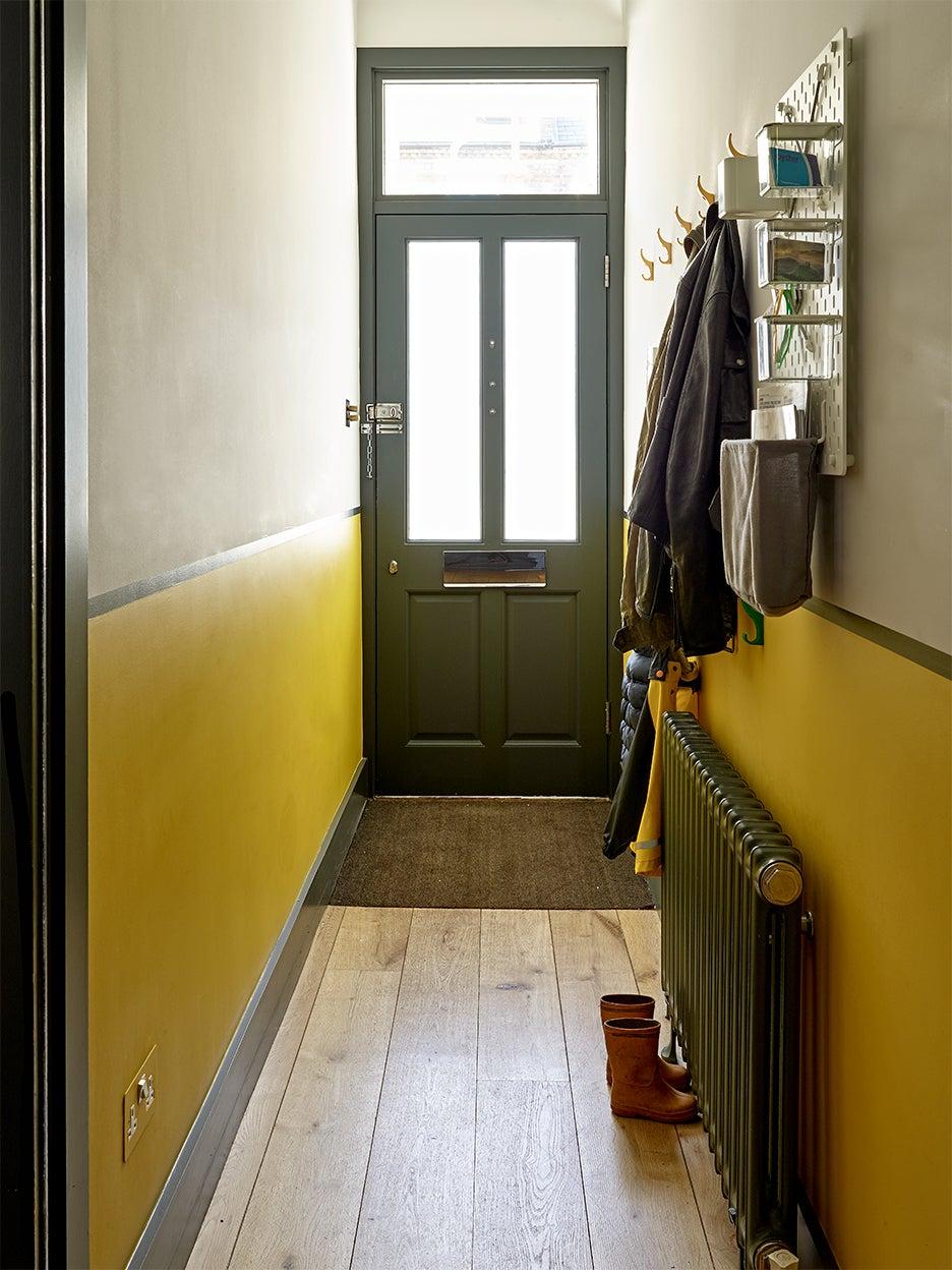Yellow hallway with dado rails