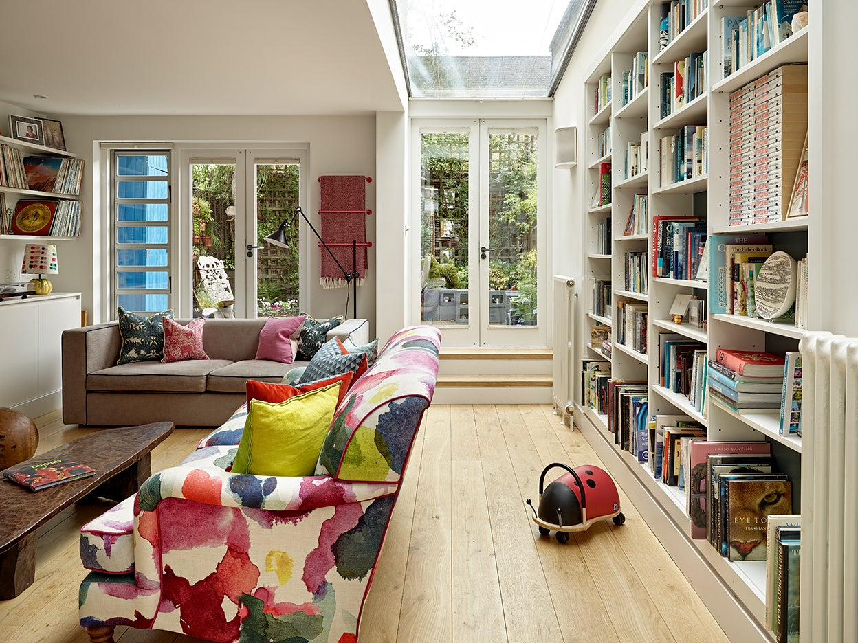 Living room with skylight and built-in bookcase