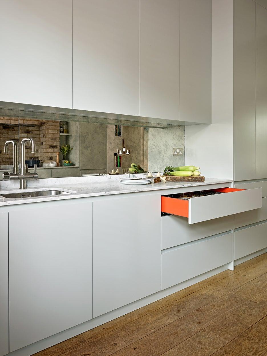 Light gray kitchen cabinets with orange interior