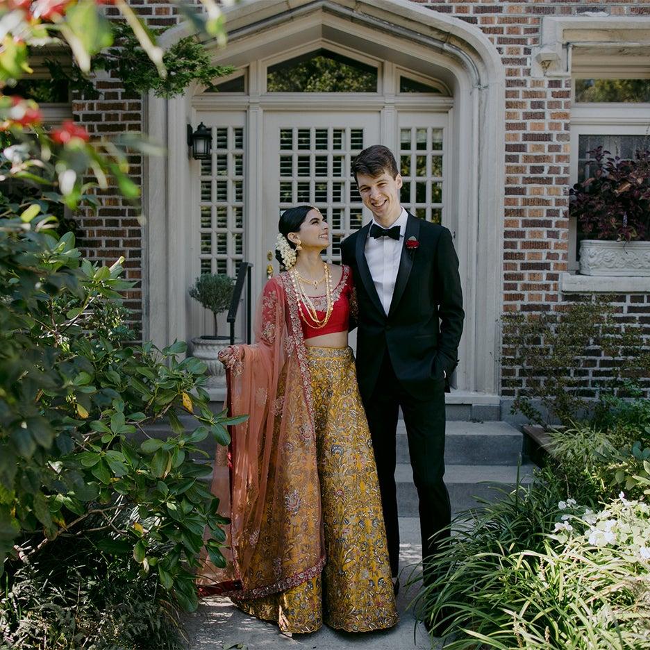 couple posing in a garden