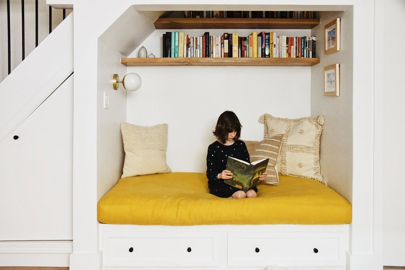 girl reading in book nook