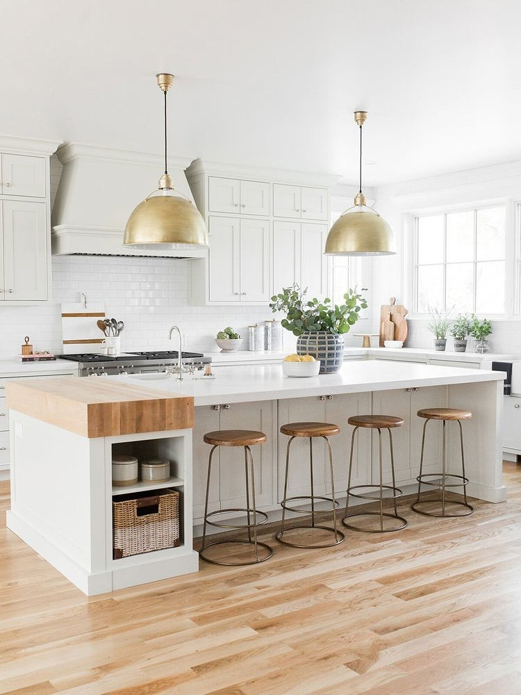 white kitchen with large brass lights