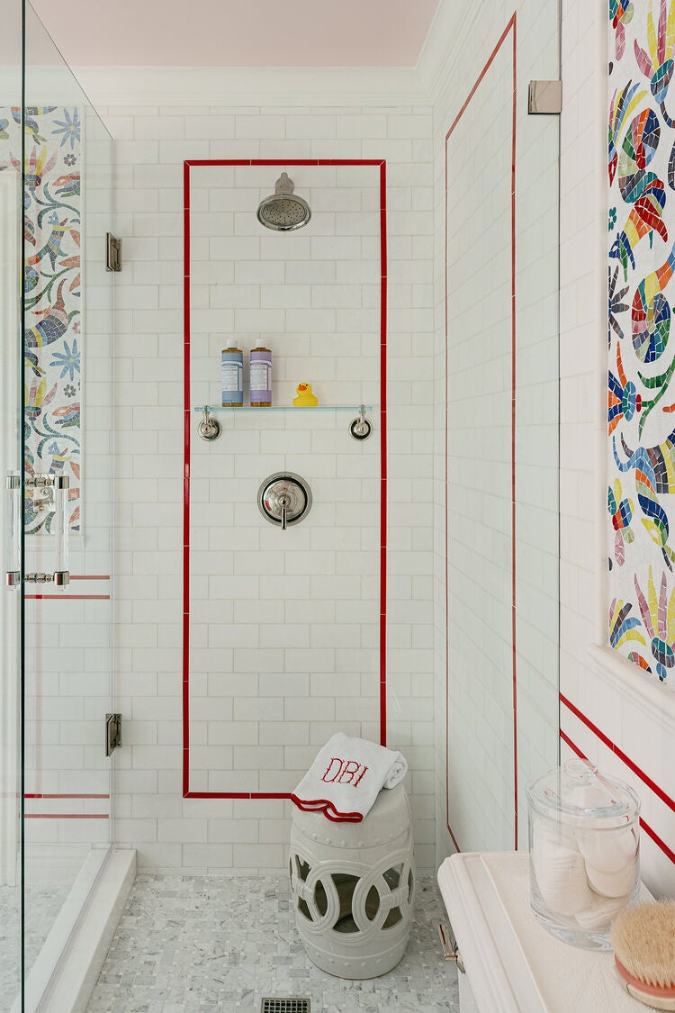 Shower with white subway tile and red border