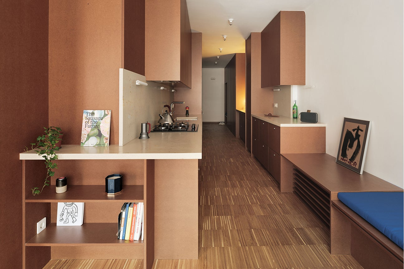 long hallway with brown galley kitchen