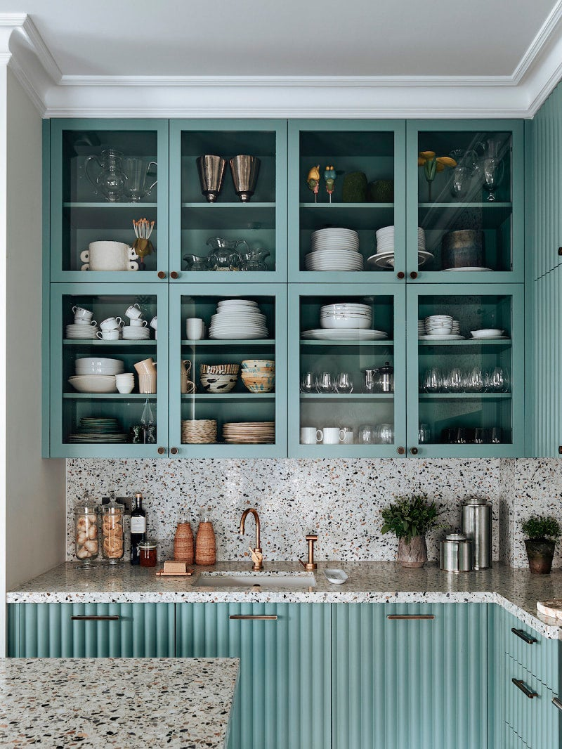 upper seafom colored cabinets with glass doors