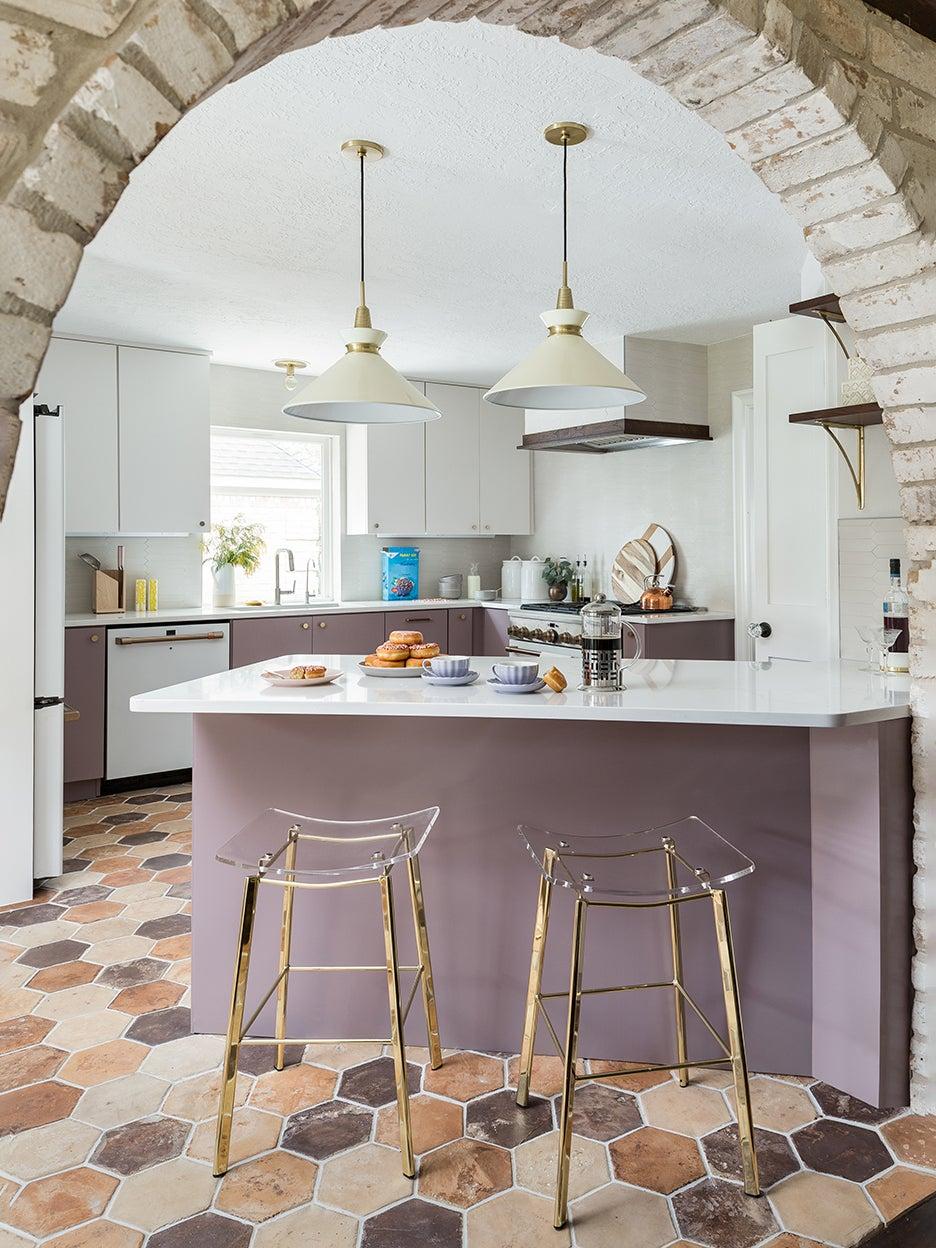 purple and white ktichen looking through arch