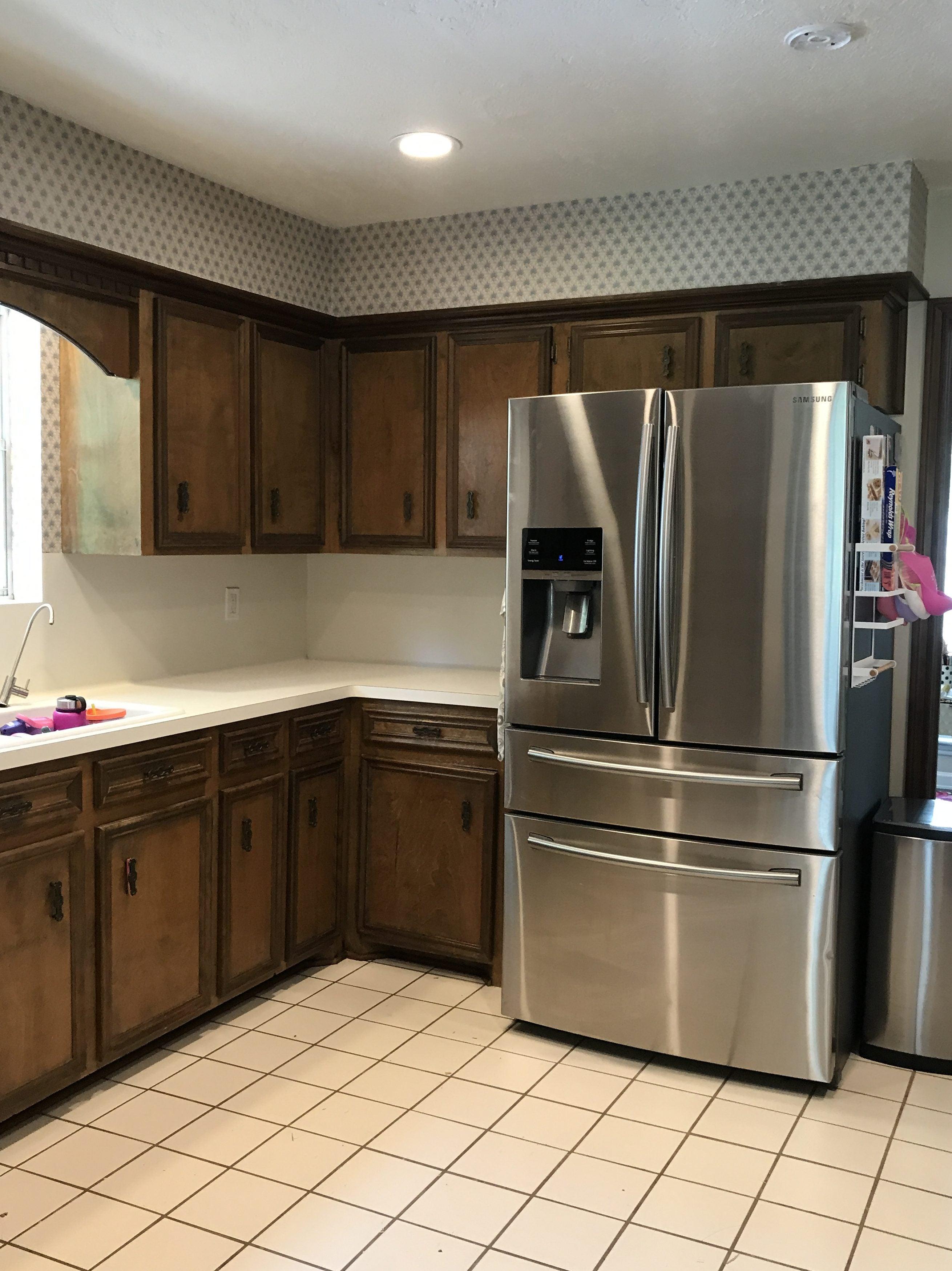 fridge in dated kitchen