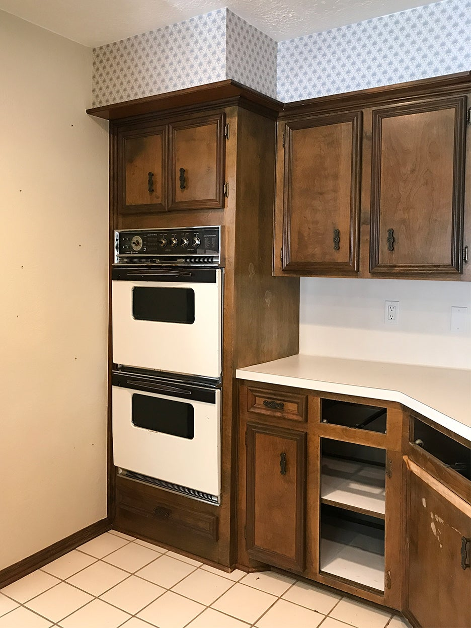drab brown cabinets with double oven