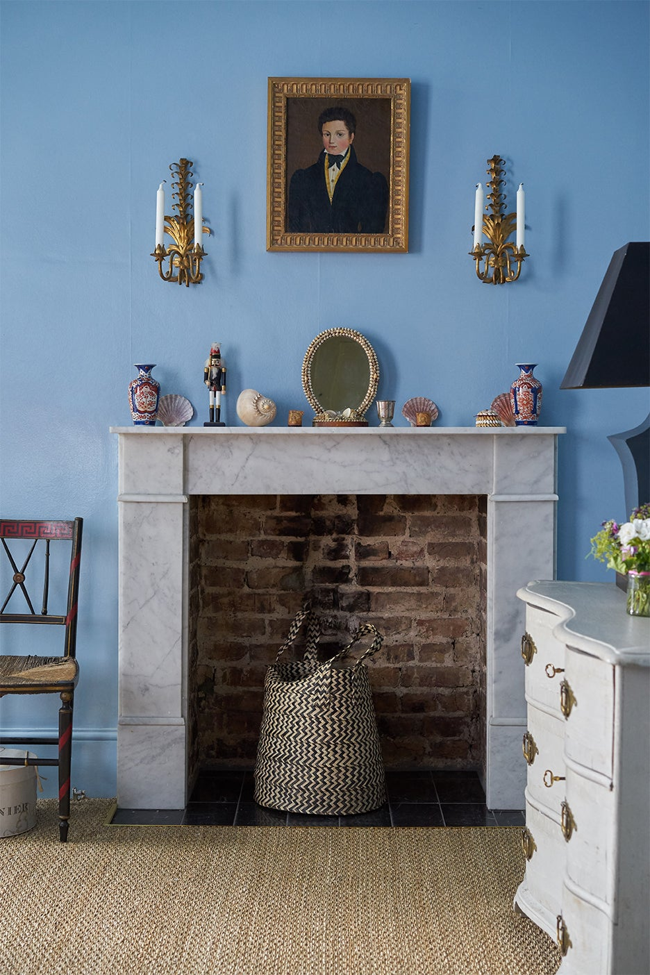 Marble fireplace in blue bedroom