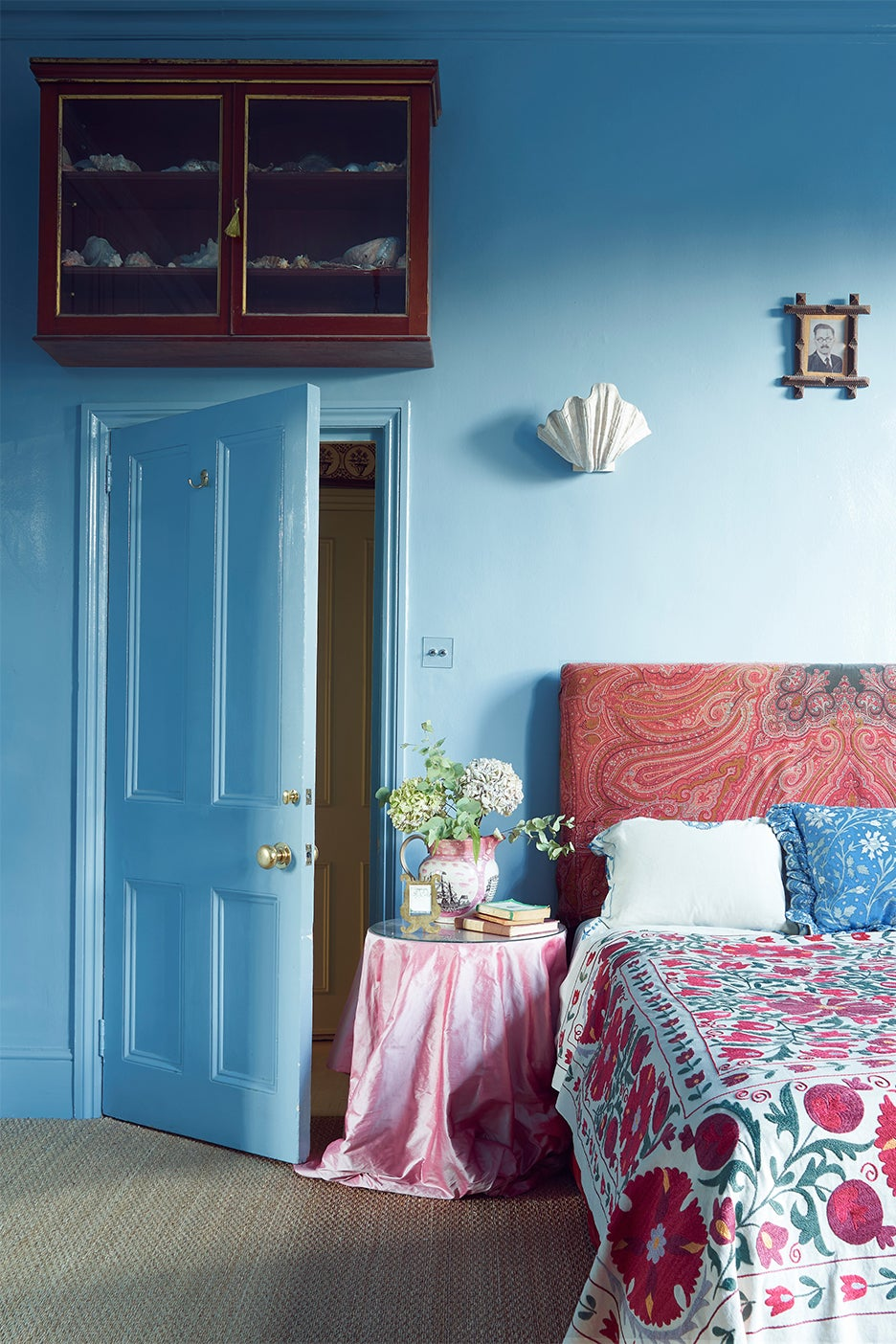 Red headboard in blue bedroom