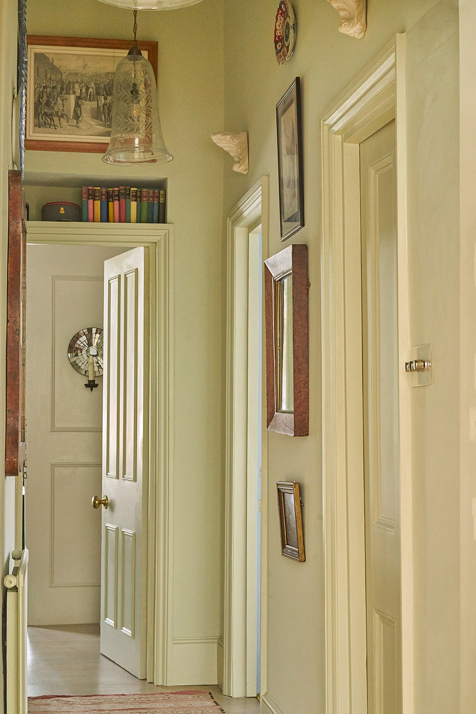 narrow hallway painted in yellow-beige