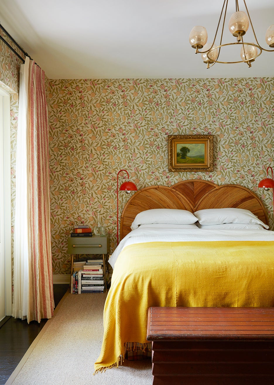 Bedroom with yellow bedspread and floral wallpaper