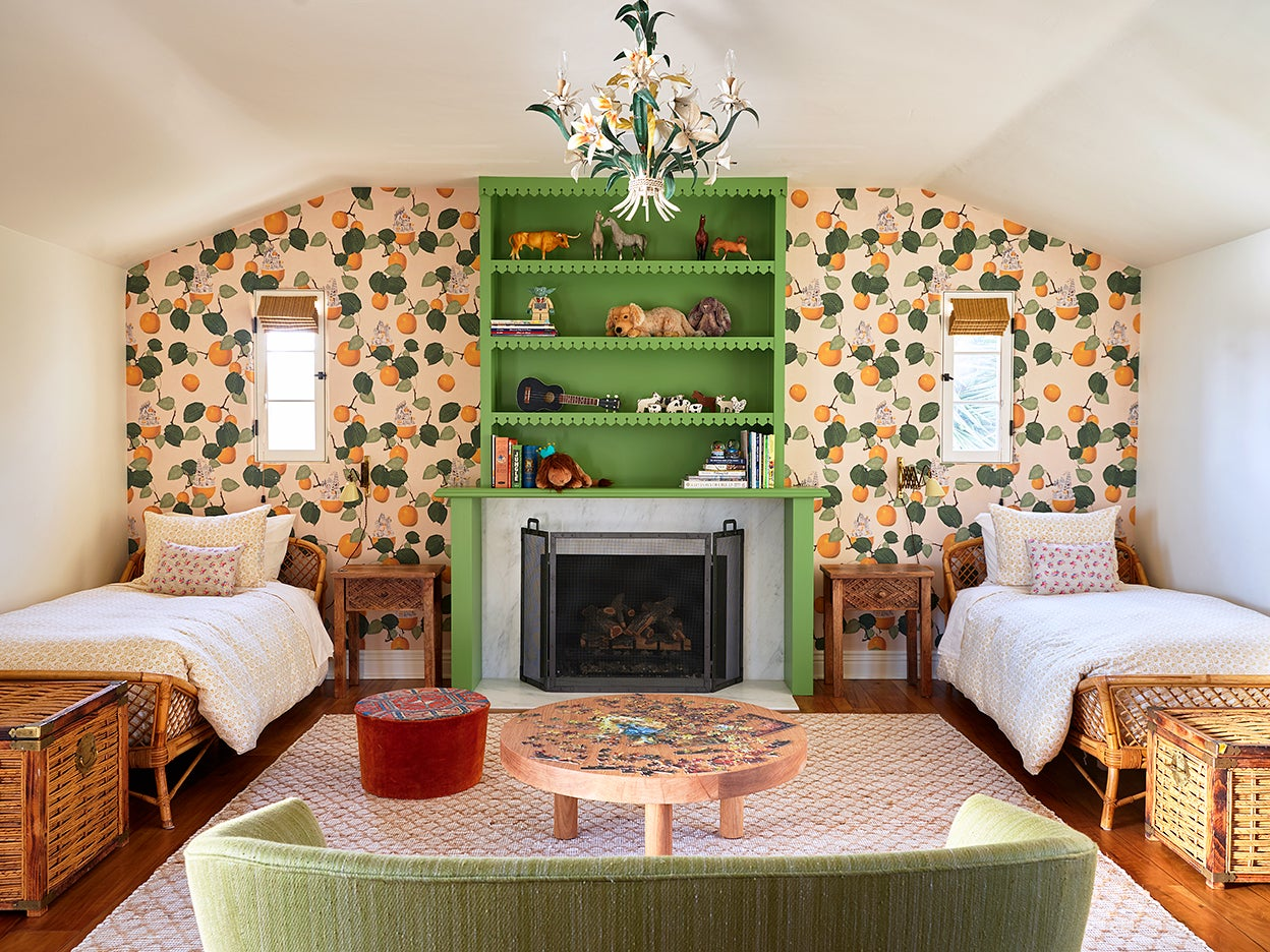 Kids room with wallpaper and green bookcase
