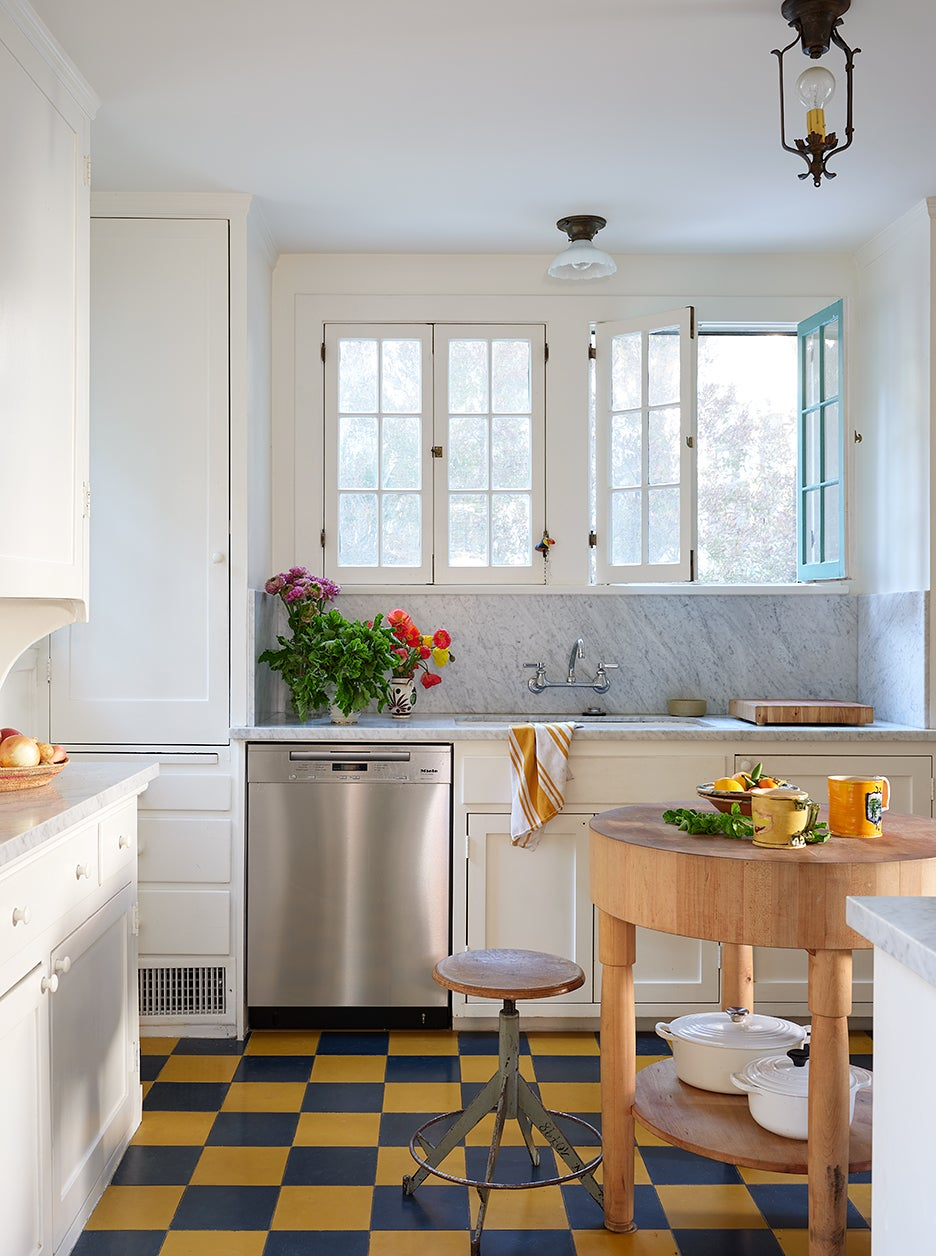 White kitchen with blue and yellow checkered floors