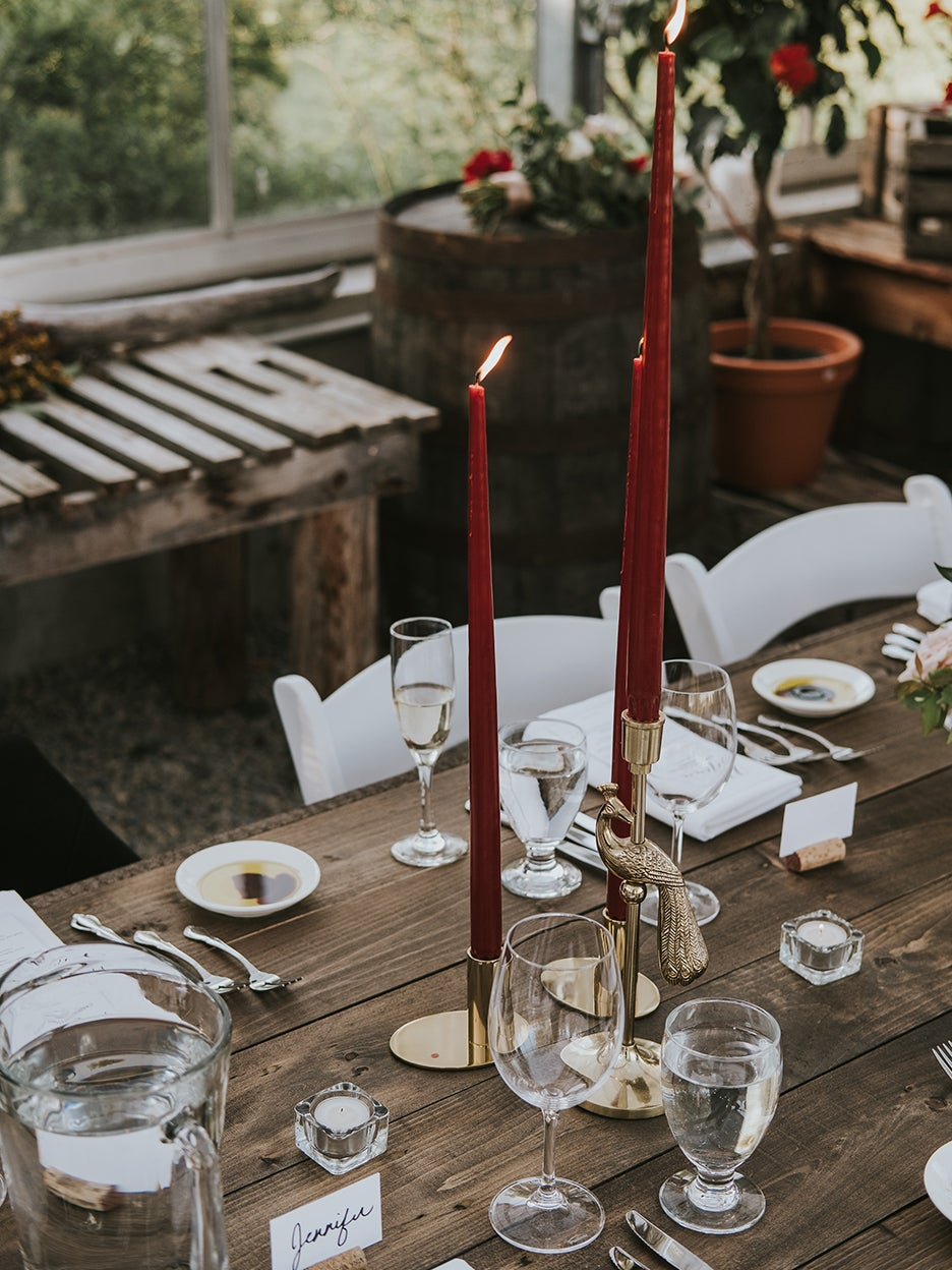 Dinner table with red taper candles