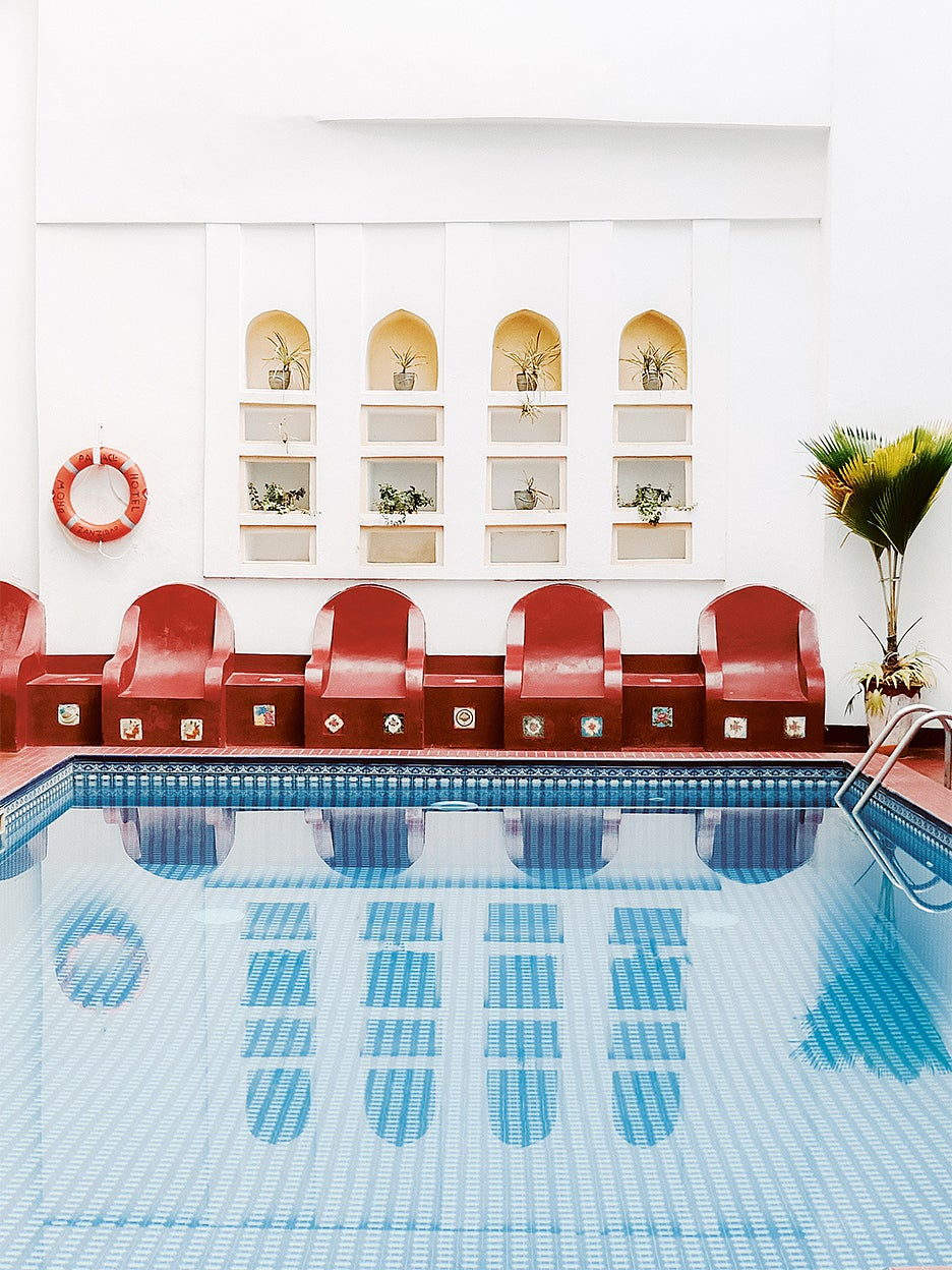 Indoor pool with red chairs