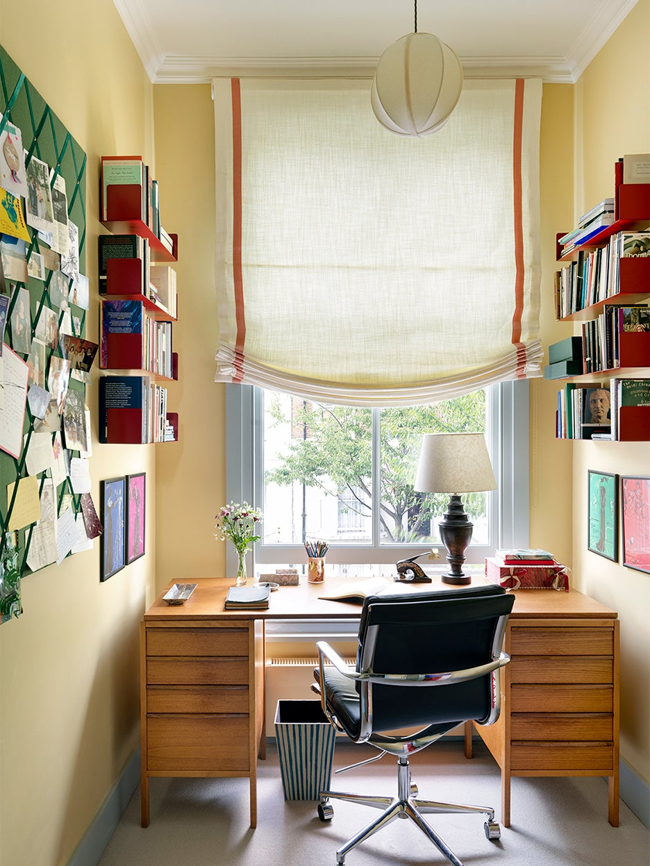 Yellow home office with yellow soft roman shade
