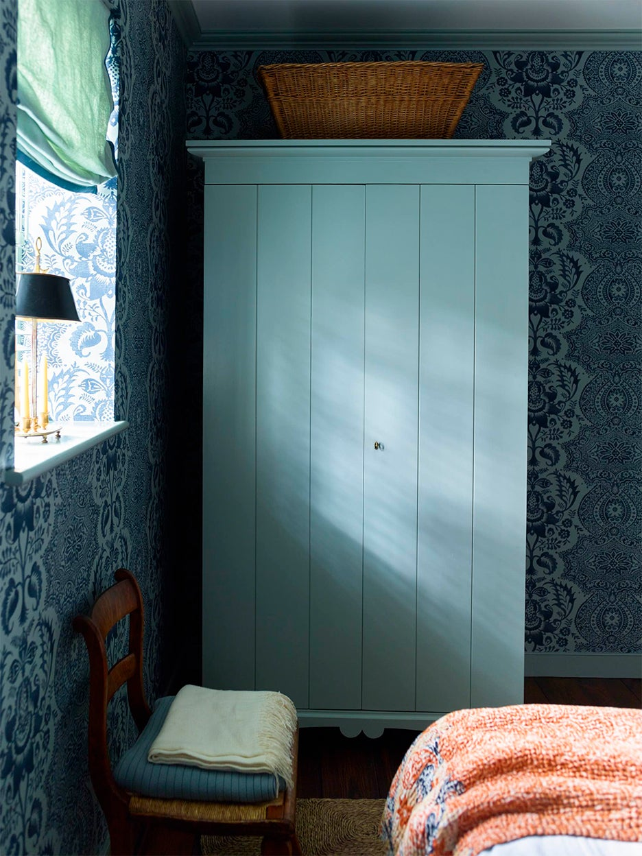 Blue bedroom with soft roman linen shade