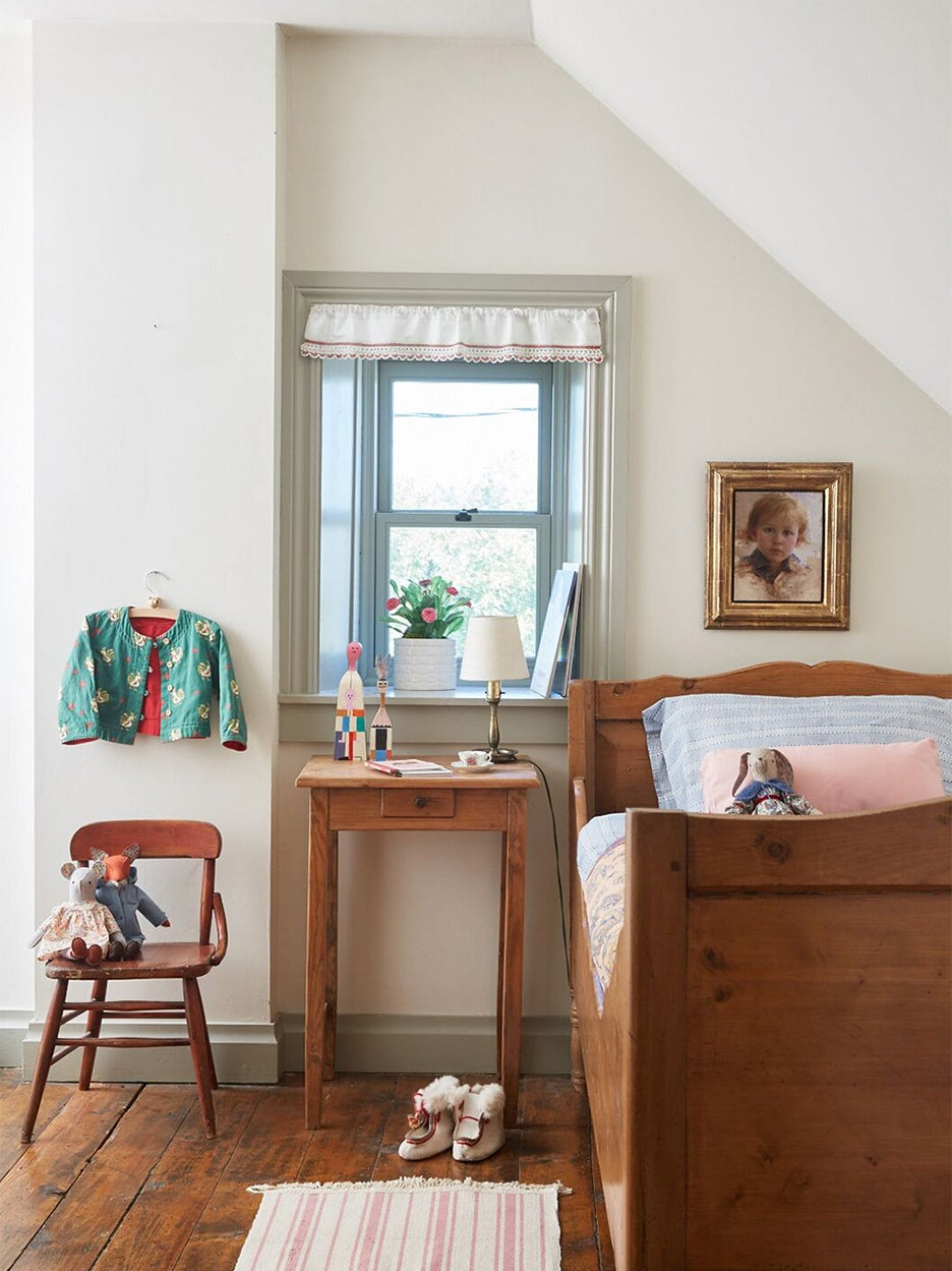 Antique bed in white bedroom