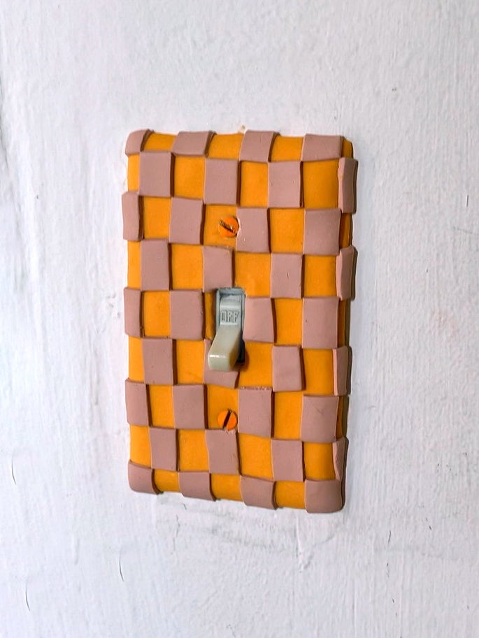 orange and pink light switch cover