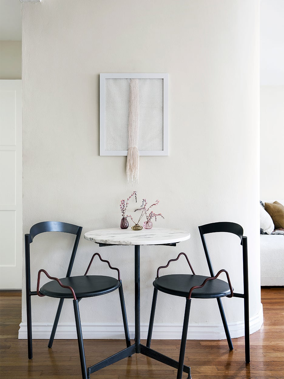 marble bistro table with black chairs