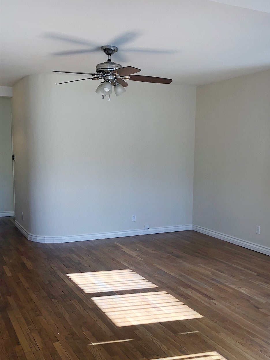 beige empty room with curved wall
