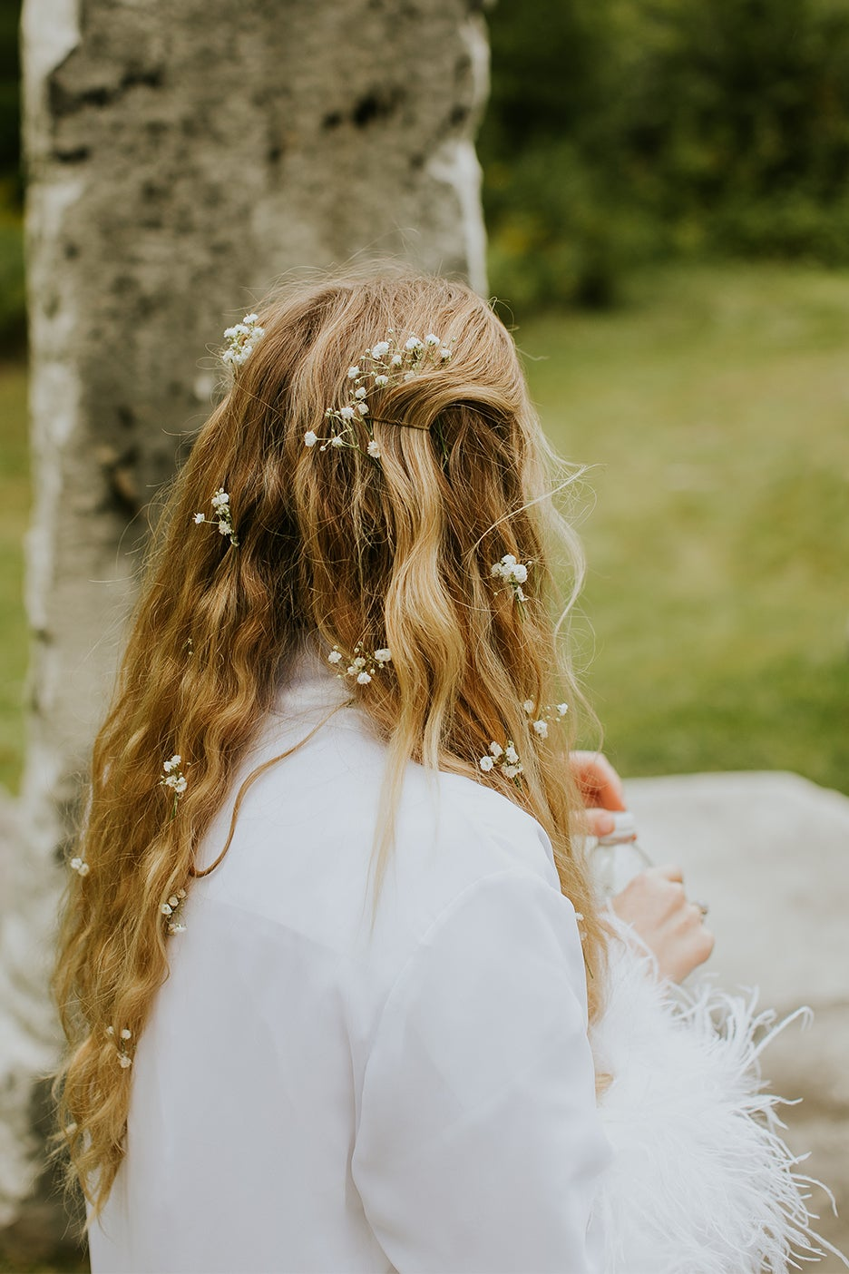Baby's breath in bride's hair