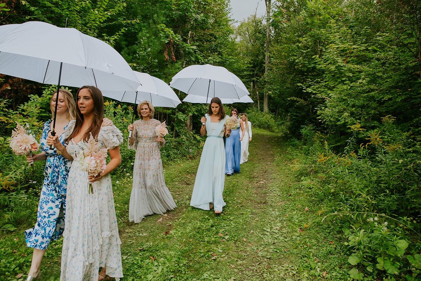 Wedding guests with umbrellas