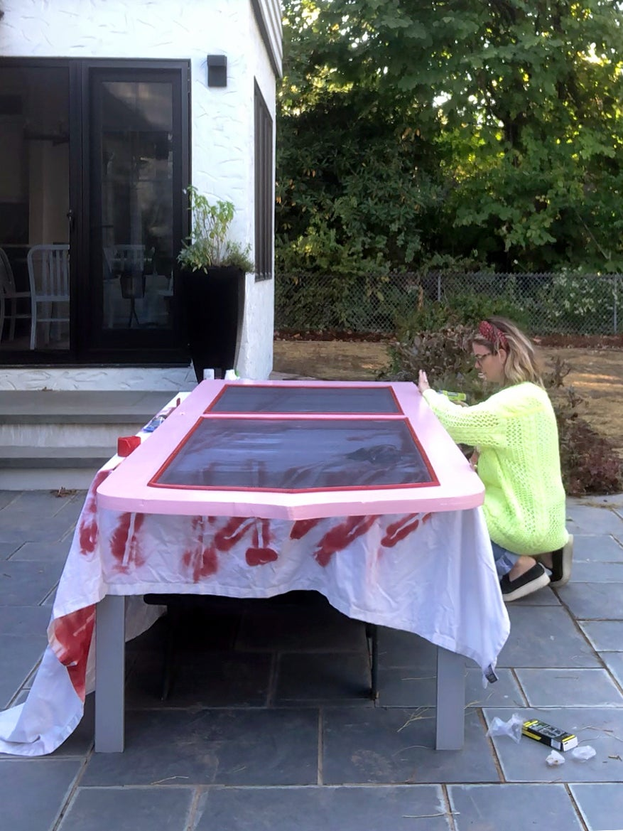 person painting door on table