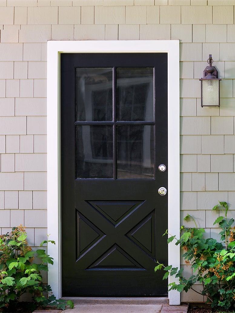 gray house with black door