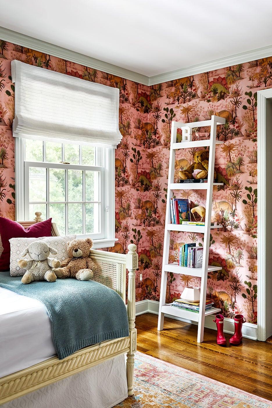 pink dinosaur wallpaper in girls room