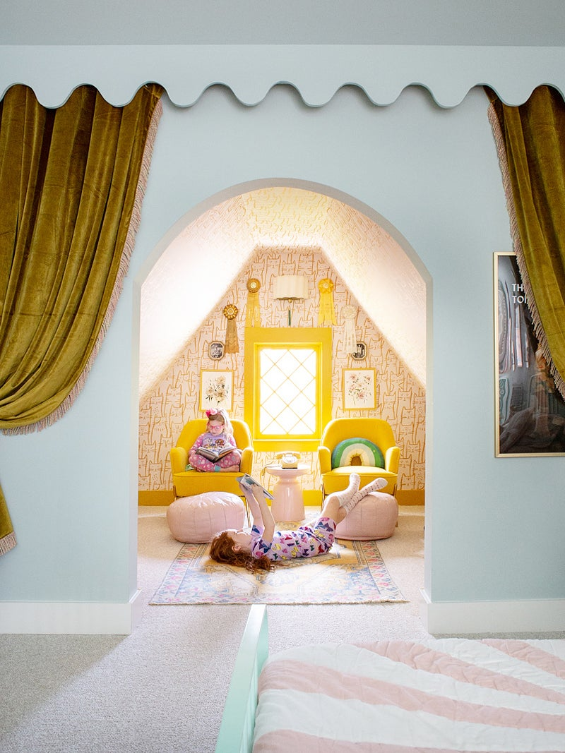 Arched opening with velvet curtains in kids room