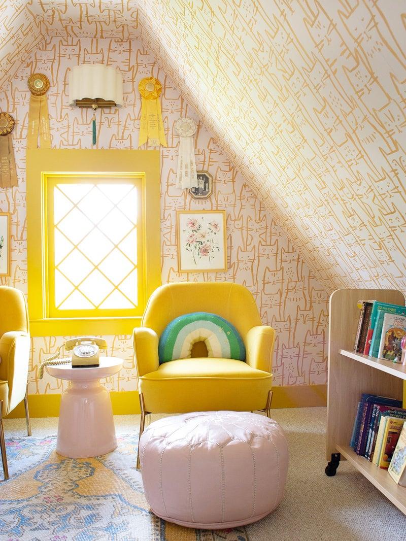Wallpapered yellow kids playroom