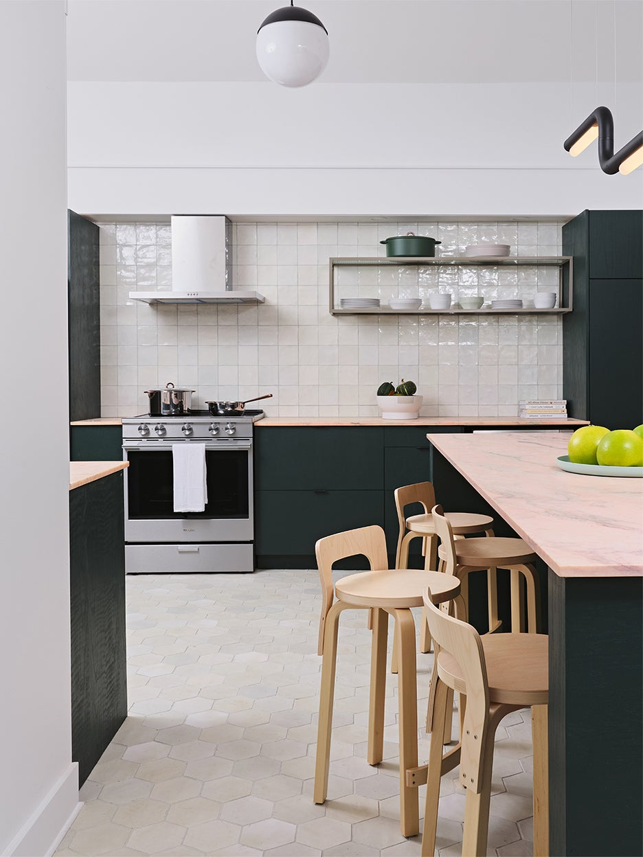 green kitchen with pink counters