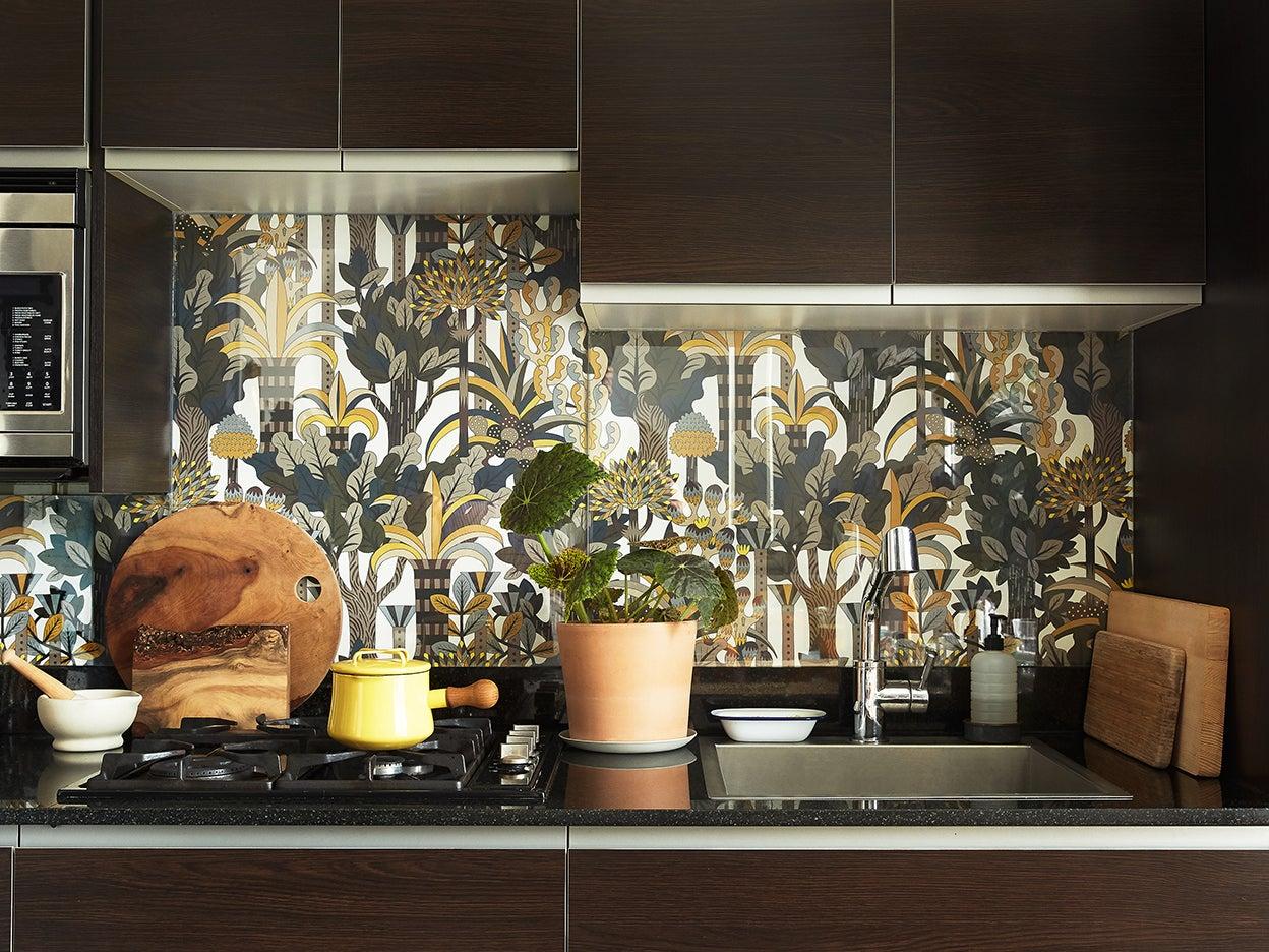 espresso cabinets with floral backsplash