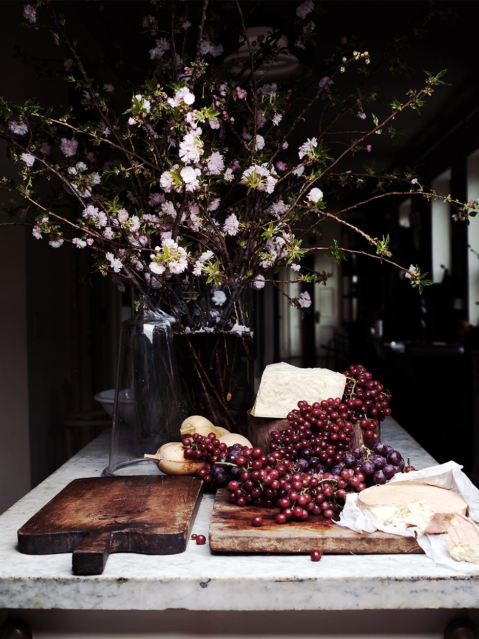 cheese and grapes on table