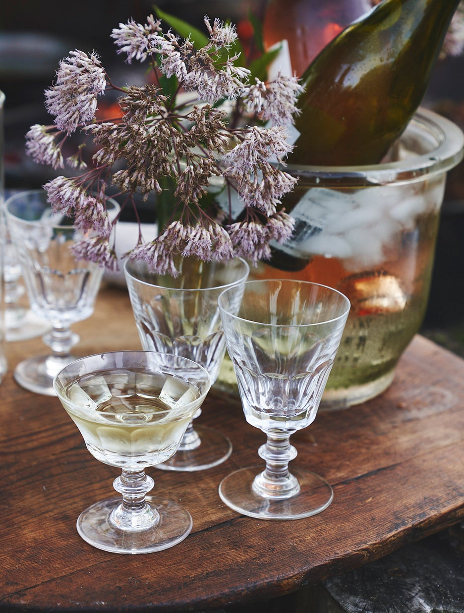 flowers in drinking glasses